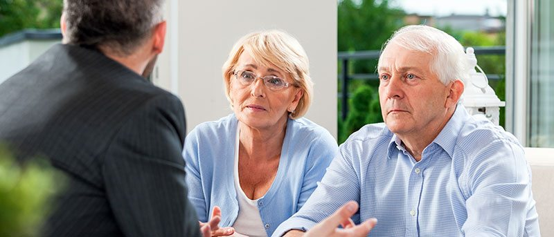 Older Couple Talks with Lawyer